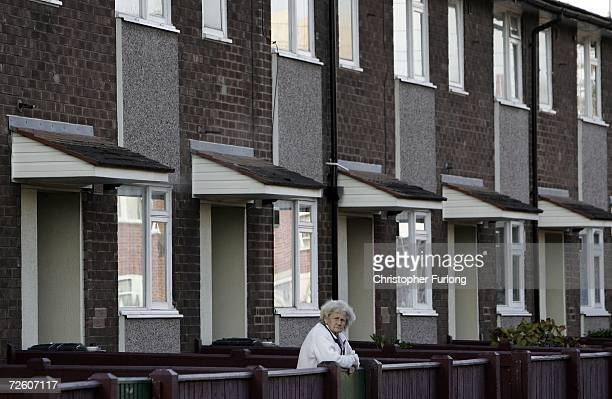 A woman whiles away the time outside her council home One of the thousands of council houses in England which according to a report by The Rowntree...