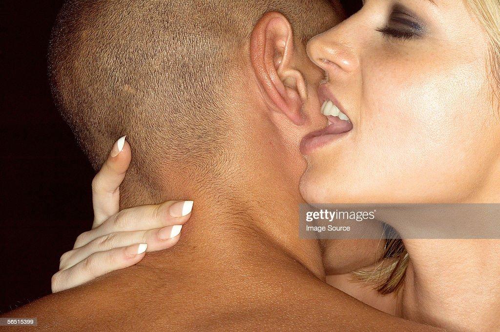 Woman whispering in mans ear : Stock Photo