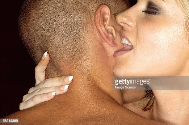 woman whispering in mans ear - heterosexual couple photos stock photos and pictures