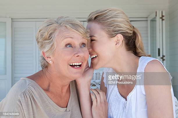 A woman whispering to her mother