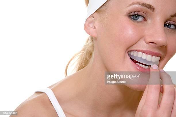 Woman whitening teeth