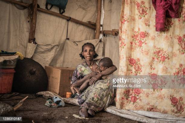 Woman who fled the war from May Tsemri poses for a photograph as she takes shelter in a temporarily built camp in Dabat, 70 kilometres Northeast of...