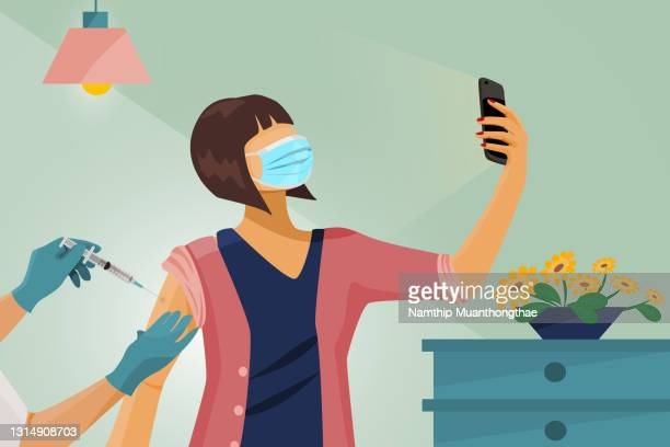a woman who has been injected the covid-19 vaccine in the hospital is taking a photo of herself when get the vaccine by using the illustration technique. - department of health stock pictures, royalty-free photos & images