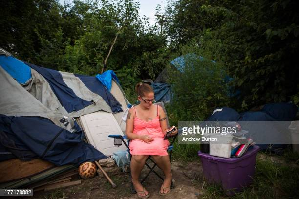 A woman who identified herself as Jessica sits next to the tent she lives in on August 21 2013 in Camden New Jersey Camden has at least three tent...