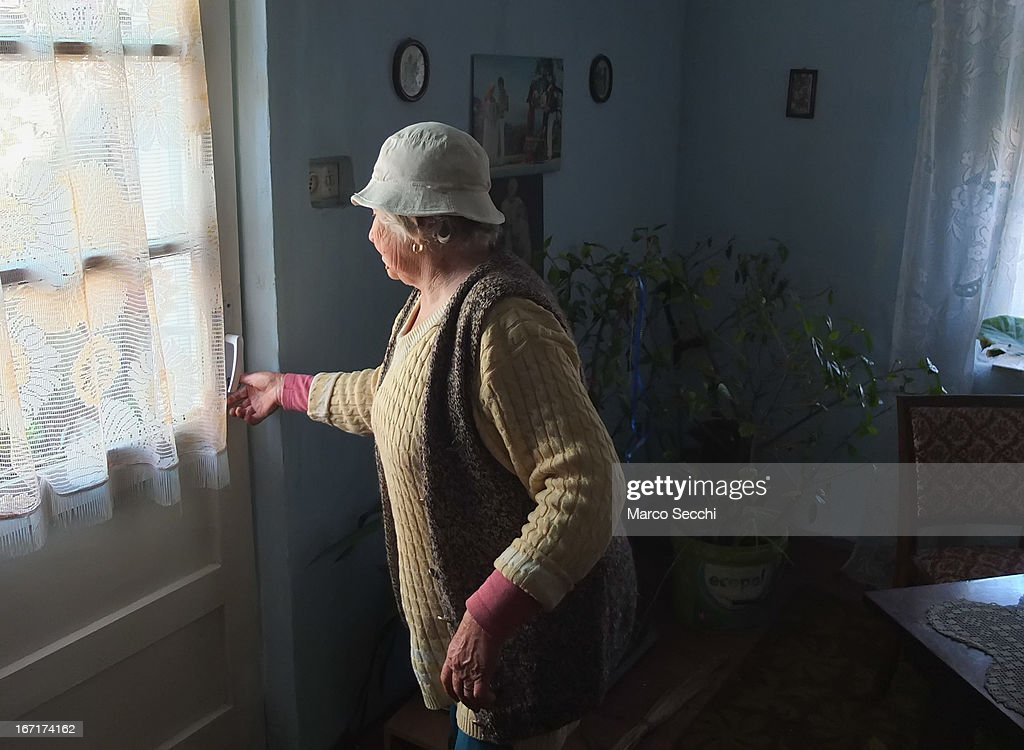 A woman who lives in the outskirt of the city shows her house on April 16, 2013 in Timisoara, Romania. Romania has abandoned a target deadline of 2015 to switch to the single European currency and will now submit to the European Commission a programme on progress towards the adoption of the Euro, which for the first time will not have a target date.