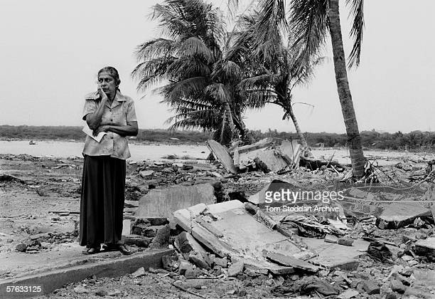 A woman who lost her husband stands silently at the wreckage of their home in Hambantota Sri Lanka On December 24th 2004 waves up to sixty feet high...