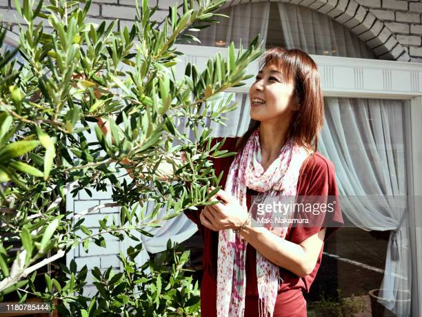 woman who loves vegetation - maebashi city stock photos and pictures