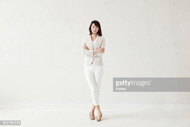 a woman who makes a pose - brown jacket stock pictures, royalty-free photos & images