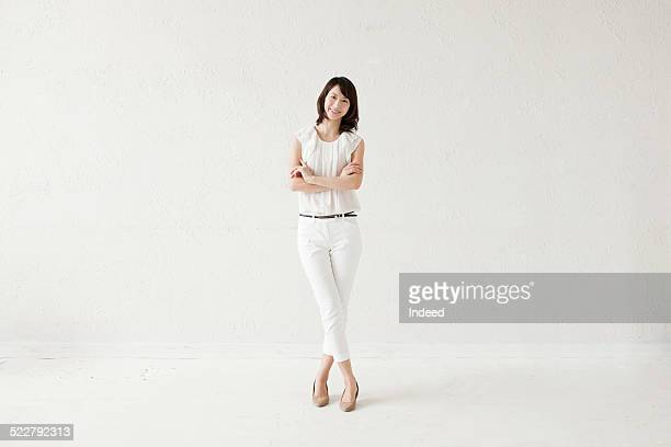 a woman who makes a pose - white pants stock pictures, royalty-free photos & images