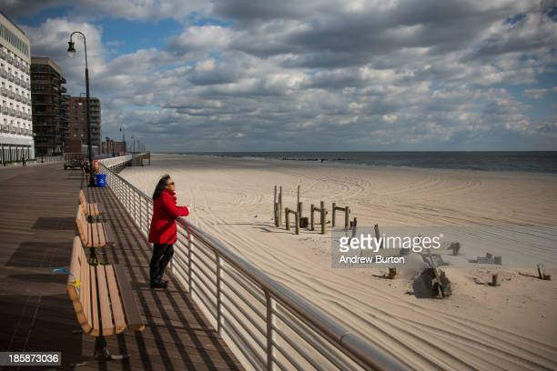 A woman who only identified herself as Gigi looks out to see from the Long Beach boardwalk on October 25 2013 in Long Beach New York The Long Beach...