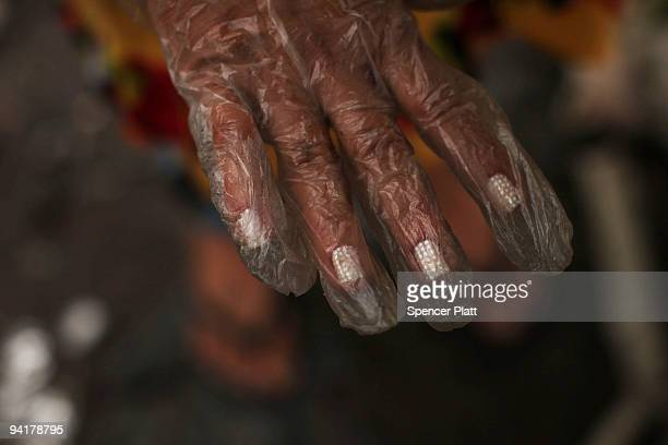 A woman who picks through trash for a living displays her manicured fingernails at the Jardim Gramacho waste disposal site on December 9 2009 in...