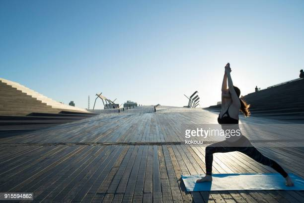 a woman who plays yoga outdoors. - pelvis stock pictures, royalty-free photos & images