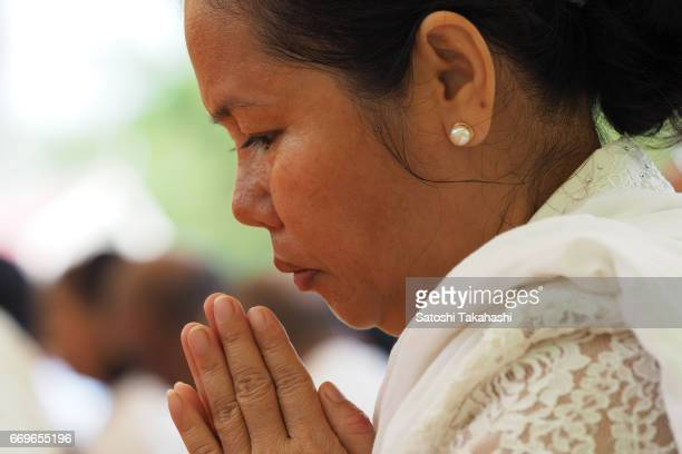 Woman who prays to victims of Pol Pot regime during a memorial service to mark the 42nd anniversary of the fall of Phnom Penh to the Khmer Rouge at...