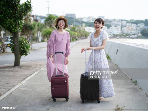 a woman who takes a suitcase and travels together - 旅行 ストックフォトと画像
