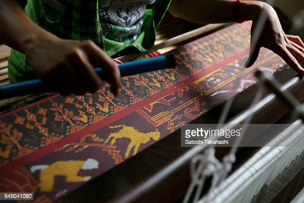 CYK'S WEAVING TRAINING CENTER TAKEO PROVINCE CAMBODIA A woman who weaves Pidan with a traditional weaving machine for the revival of Cambodia's...