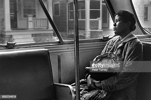 A woman who works as a cleaning lady rides the bus home in Fort Wayne Indiana
