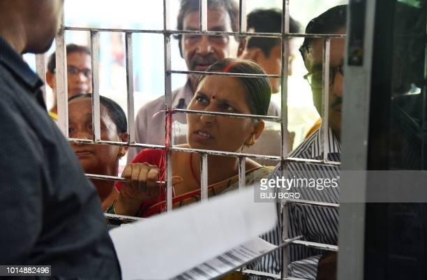 A woman whose name is left out in the National Register of Citizens draft stands in a queue to collect forms to file appeals at a NRC Sewa Kendra in...