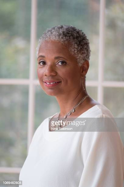 a woman embracing her age with a carefree natural hairstyle. - philanthropist stock pictures, royalty-free photos & images