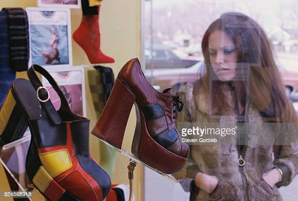 Woman Window Shopping for Platform Shoes