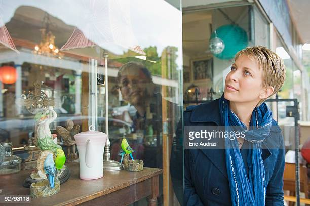 Woman window shopping in a store
