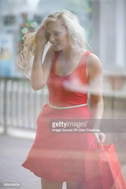 Woman window shopping on street