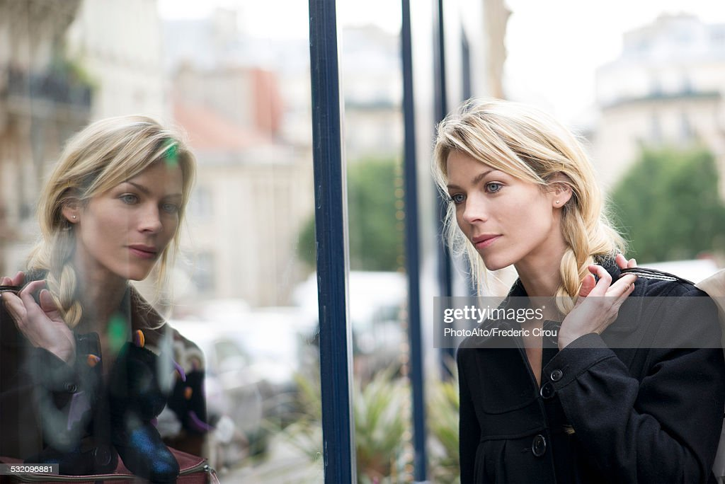 Woman window shopping : Stock Photo