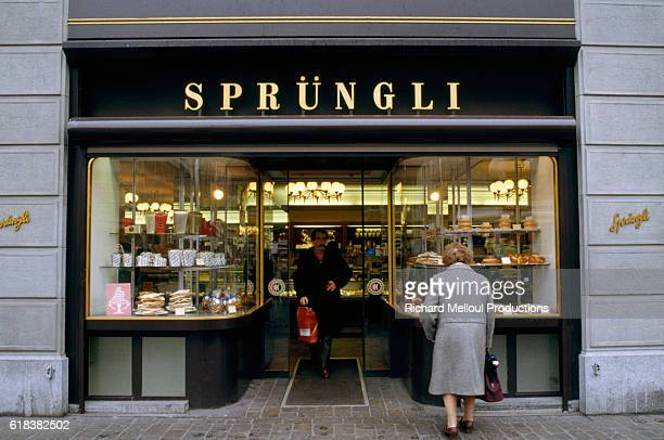 Woman window shops outside of a Belgian Lindt and Sprungli chocolate store. Confectioners Rodolphe Sprungli-Ammann and his father David...