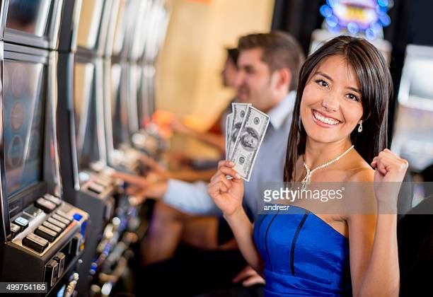 woman winning at the casino - jackpot stock pictures, royalty-free photos & images