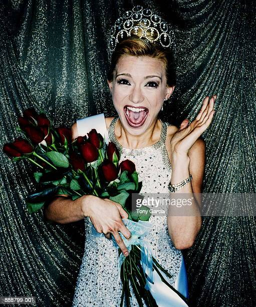 woman winning beauty contest, holding red roses (cross-processed) - beauty contest stock pictures, royalty-free photos & images