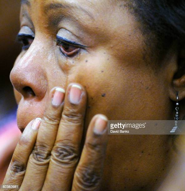 A woman wipes a way a tear at a memorial service for Bernie Mac at the The House of Hope Church on August 16 2008 in Chicago Illinois