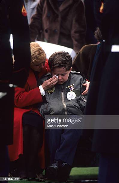 A woman wipes a young boy's tears cries during the funeral of an unidentified Desert Storm casualty at Arlington National Cemetery Arlington Virginia...