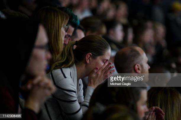 A woman wipes away tears during a candlelight vigil at Highlands Ranch High School on May 8 2019 in Highlands Ranch Colorado One student was killed...