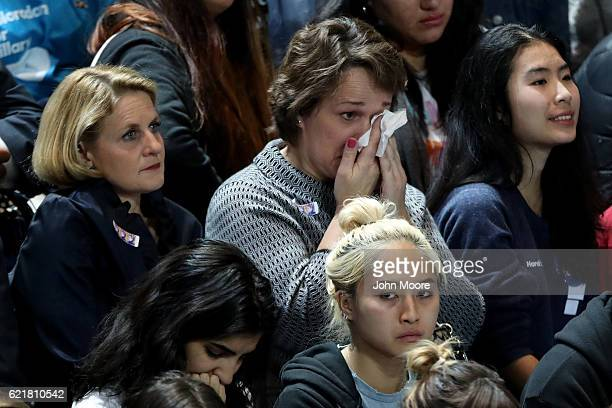 A woman wipes her eyes as she watches voting results come in at Democratic presidential nominee former Secretary of State Hillary Clinton's election...