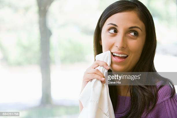 Woman Wiping at Her Mouth