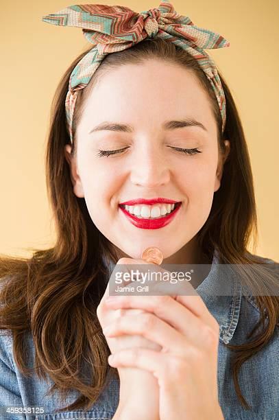 Woman wishing on penny