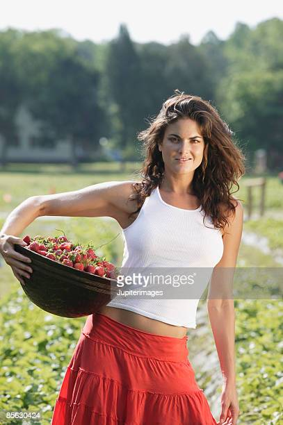 Woman with a basket of strawberries