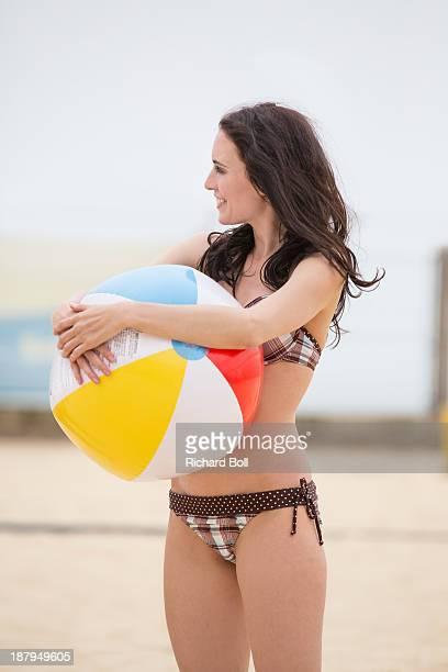 A woman with a beach ball