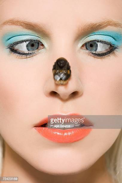 Woman with a bee on her nose