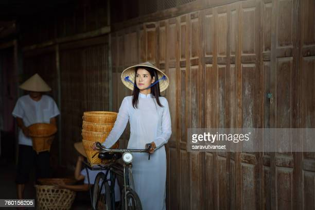 Woman with a bicycle, Vietnam