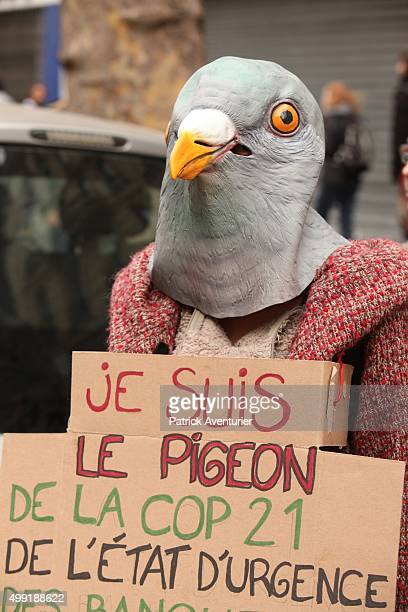A woman with a birds head mask attends the forbidden COP21demonstration on November 29 2015 in Paris FranceThe demonstration was banned after the...