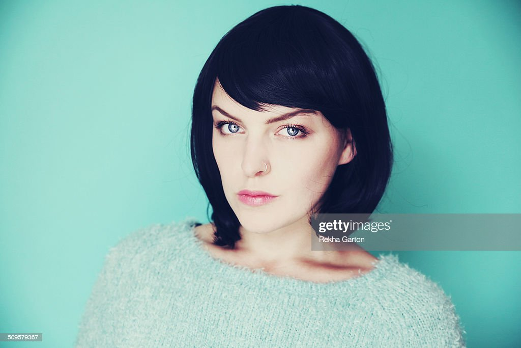 Woman with a black bob on a light blue background