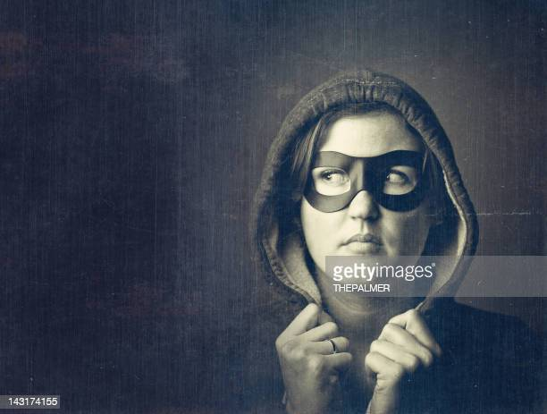 woman with a black mask - black mask disguise stock pictures, royalty-free photos & images