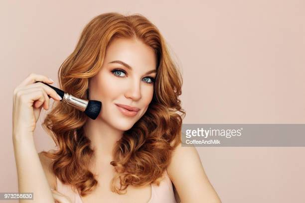 woman with a brush for make-up powder - blusher stock pictures, royalty-free photos & images