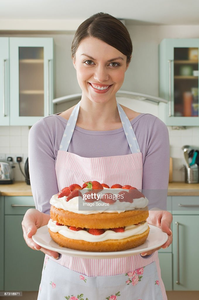 Woman with a cake : Foto de stock