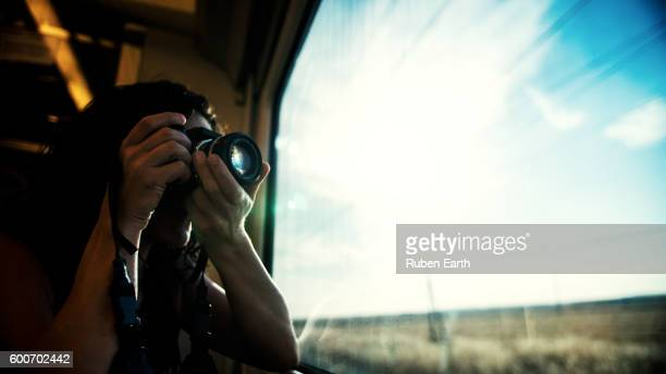 Woman with a camera at the train
