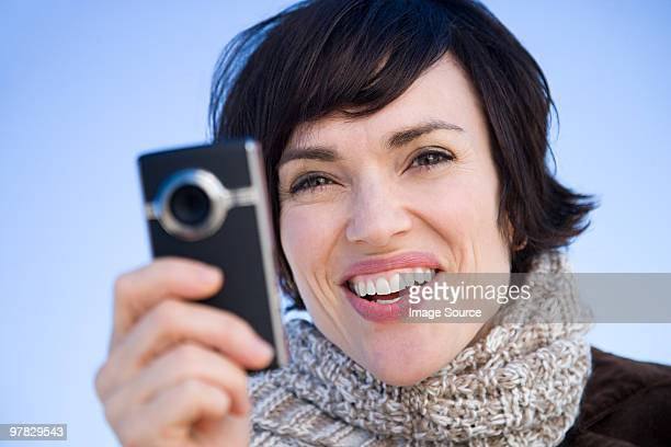 Woman with a camera telephone