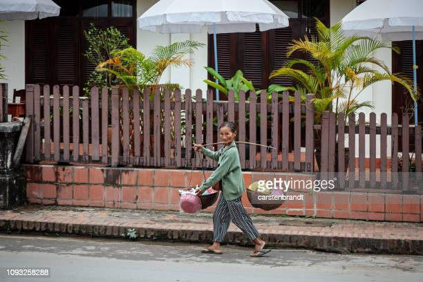 woman with a carrying stick - yoke stock photos and pictures