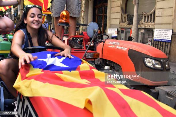 A woman with a Catalonia flag is seen on a tractor during a protest Around 400 tractors called by agricultural unions have gathered on the center of...