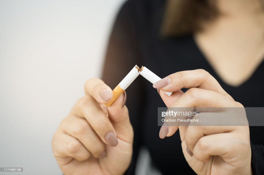 A woman with a cigarette : Stock Photo