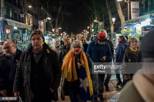 A woman with a clown nose marches by Las Ramblas in support of imprisoned Catalan independentist leaders in Barcelona Catalonia Spain on 16 February...